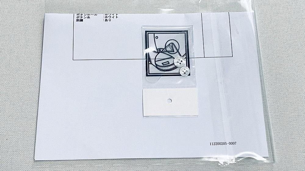 SOLVE(ソルブ) 生地W-6167-2 納品書と予備のボタン